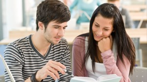 Male-and-female-student-read-book-via-Shutterstock