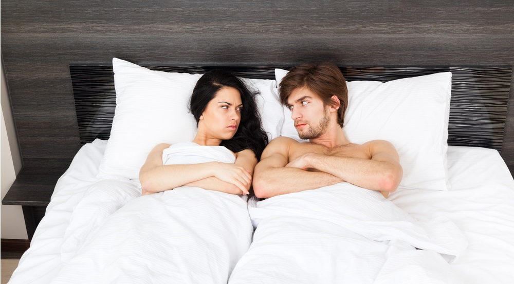Unhappy,Separate,Couple,Lying,In,A,Bed,,Having,Conflict,Problem